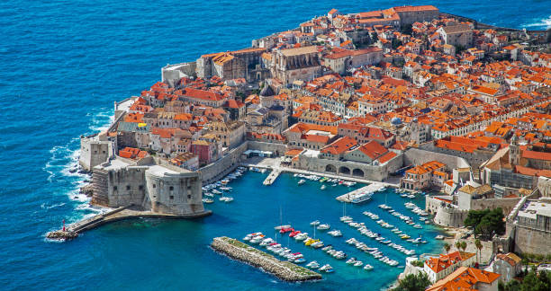 View of the harbor and the old town of Dubrovnik Croatia View of the harbor and the old town of Dubrovnik Croatia former yugoslavia stock pictures, royalty-free photos & images