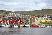 Town of Hammerfest with the port habour with fishing boats. Hammerfest is the northernmost town in the world with more than 10,000 inhabitants, county, Norway.