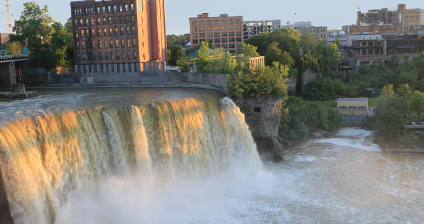 view of the high falls in the city of rochester, new york - rochester ny skyline stock photos and pictures