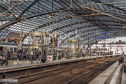 Berlin, Germany - September 27, 2018: View of the high-tech steel glass roof of the Berlin Central Station (Hauptbahnhof) at sunset. Architect: Gerkan, Marg and Partners