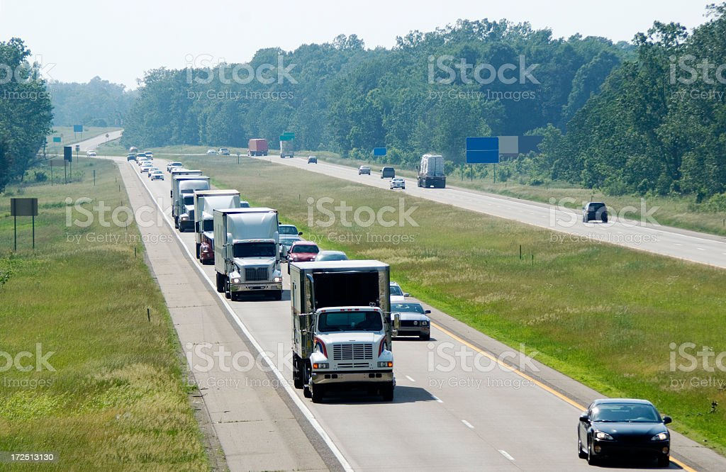 View of the highway traffic with trucks lined up stock photo