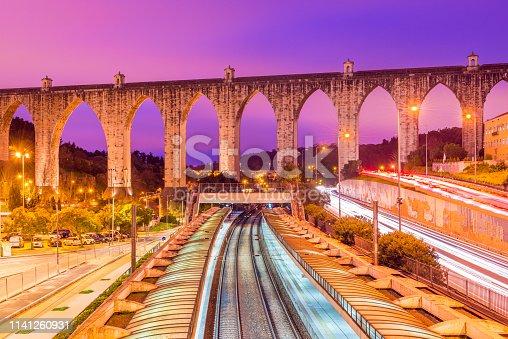 View of the historic aqueduct in the city of Lisbon (Aqueduto das Águas Livres), Portugal. Train station