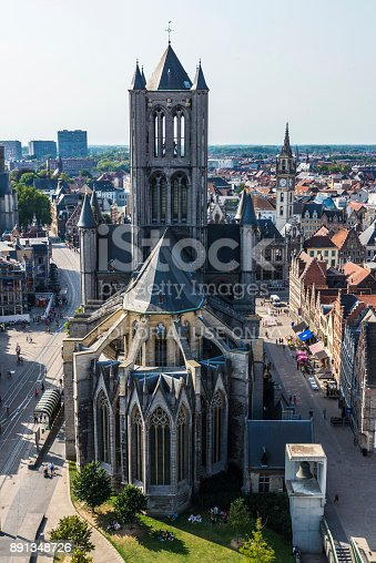 Ghent: View of the Saint Nicholas Church with people walking in the old town of the medieval city of Ghent, Belgium