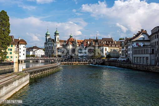 View of the historic Jesuit Church with Reuss River in Switzerland.