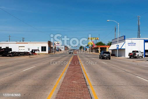 Clinton, Oklahoma, USA - July 8, 2014: View of the historic US route 66 near the city of Clinton, in the State of Oklahoma, USA, with the sign for The Glancy Motel.