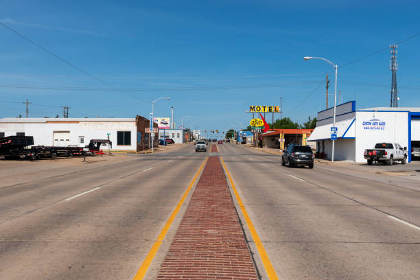 View of the historic US route 66 near the city of Clinton, in the State of Oklahoma, USA, with the sign for The Glancy Motel. stock photo