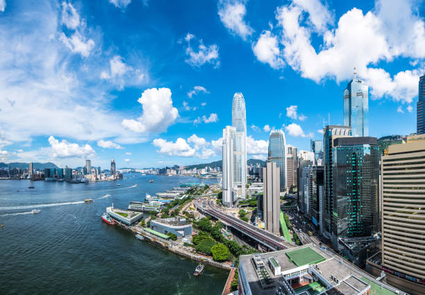 View of the Hong Kong skyline. Hong Kong, Victoria Harbour - Hong Kong, Hong Kong Island, Urban Skyline, Asia brics stock pictures, royalty-free photos & images