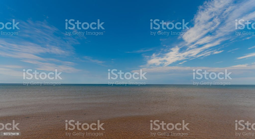 View of the horizon on a warm sand beach in a sunny day at Prince Edward Island Canada stock photo