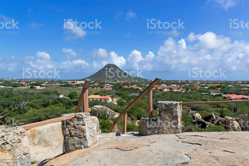 View of the houses on the Island of Aruba with the background of the mountain stock photo