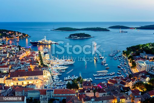 istock View of the illuminated old town Hvar and the harbor with Pakleni Islands at dusk 1043656518