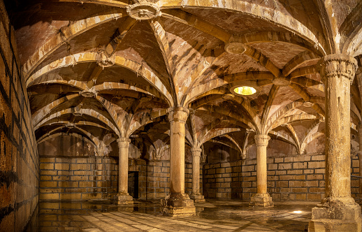 Tomar, Portugal - June 3, 2021: The cistern was intended to store water for irrigation and was built between 1543 and 1546. Most of the Convent's cisterns are located on the underground floor of the main cloisters. Its purpose was to serve as a reservoir for rainwater.
