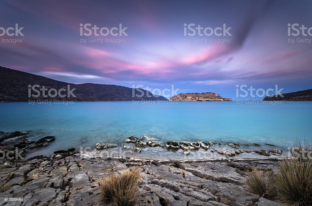 View of the island of Spinalonga at sunset stock photo