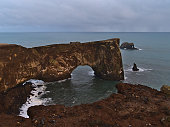 istock View of the large majestic natural rock arch of Dyrhólaey peninsula, located at ring road near Vík í Mýrdal in southern Iceland, with rough Atlantic ocean. 1313856036
