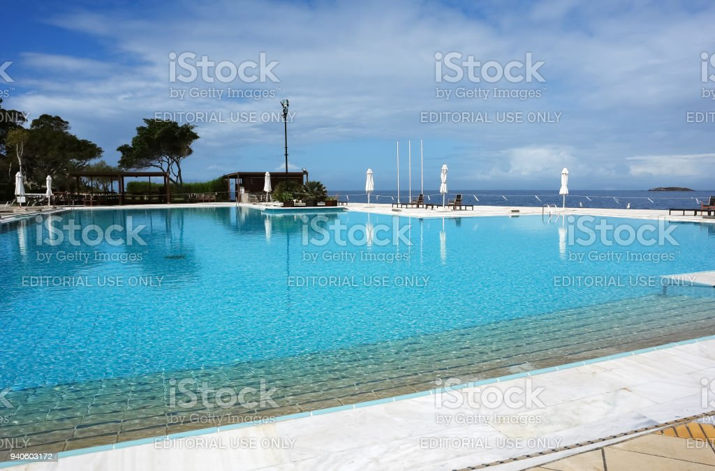 View of the large pool and the blue sea in Greece. stock photo