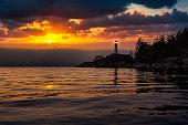 istock View of the Lighthouse Park. Dramatic Colorful Sunset Artistic Render. 1285691851