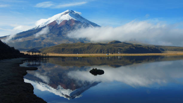 view of the limpiopungo lagoon with the cotopaxi volcano reflected in the water on a cloudy morning - alejomiranda stock pictures, royalty-free photos & images