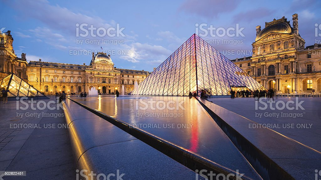 View of the Louvre Museum and the Pyramid at twilight. stock photo