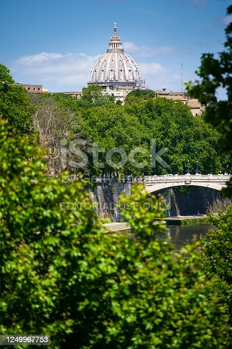 Rome, Italy, June 12 - A view of the Lungotevere near Trastevere, in the center of Rome. In the background emerges the majestic dome of St. Peter's Basilica. Image in High Definition Format