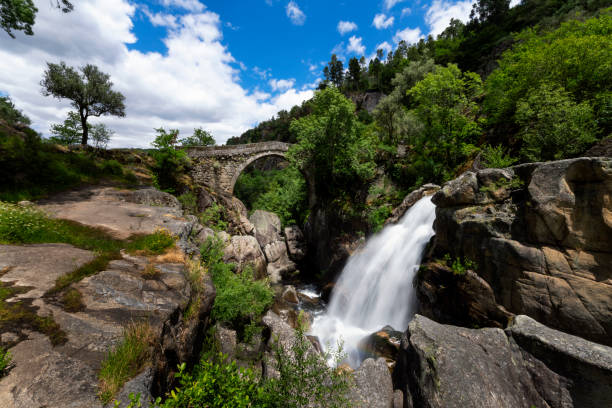 View of the Mizarela Bridge with a waterfall at the Peneda Geres National Park stock photo