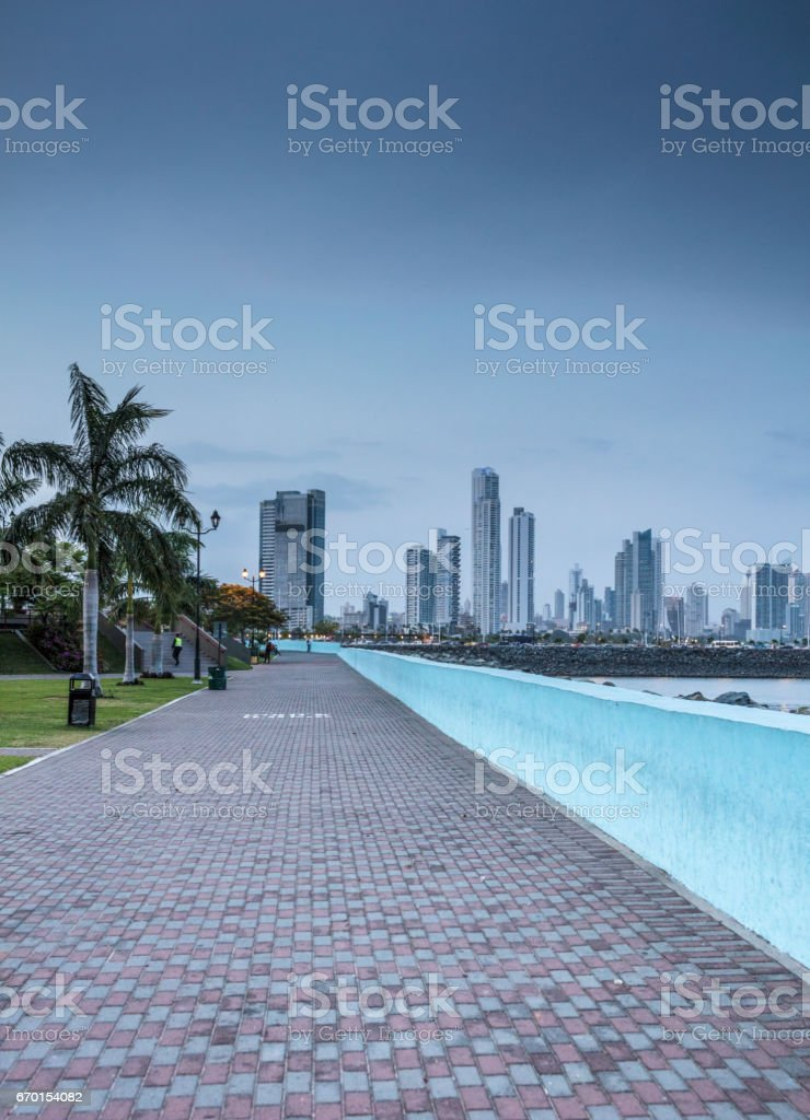 View of the modern side of Panama City with its promenade and high rise buildings in background, right by the Pacific Ocean. stock photo