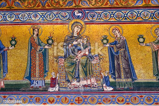 Rome, Italy -- A detailed view of the mosaics on the romanesque facade of the church of Santa Maria in Trastevere, founded by Pope Callixtus I in 222 AD. and completed by Pope Julius I around 350 AD. Image in High Definition format.