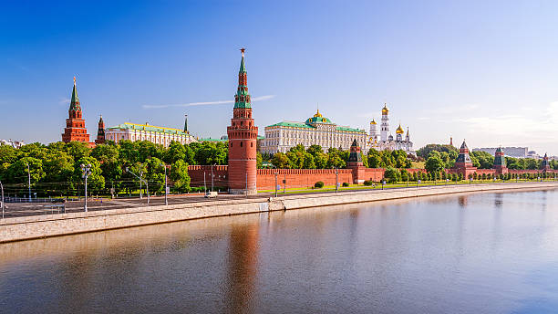 View of the Moscow Kremlin View of the Moscow Kremlin in the morning with Big Stone Bridge kremlin stock pictures, royalty-free photos & images