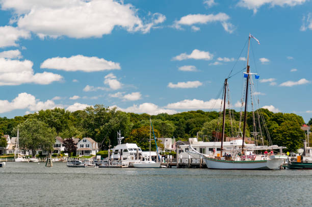 View of the Mystic Seaport with boats and houses, Connecticut stock photo