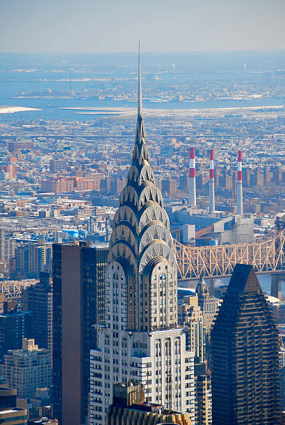 view of the new york city skyline in manhattan - chrysler building stock photos and pictures