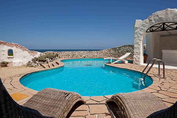 View of the ocean and pool in a resort setting stock photo