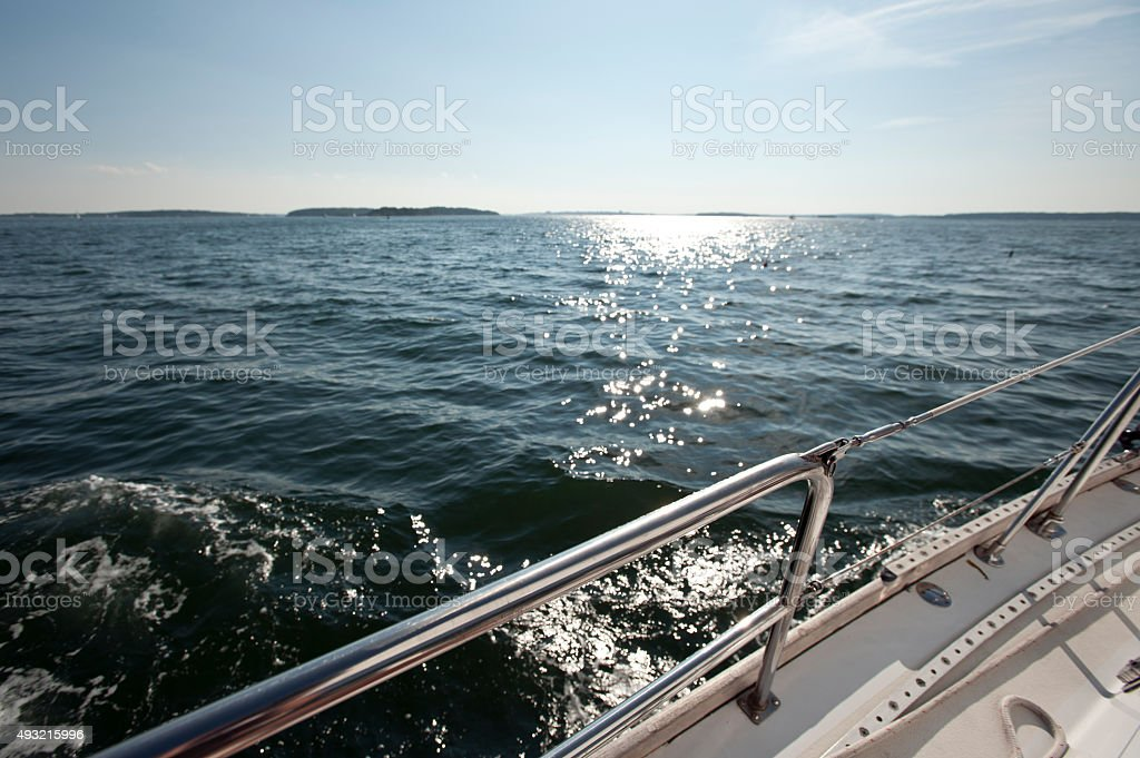 View of the ocean from a heeling sailboat stock photo