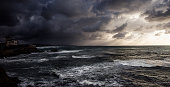 View of the ocean with rocks from Biarritz, France, cloudy skie, storm