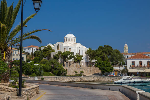 View of the old harbor of Spetses island with the church of St Nicolaos in the background. Saronic gulf, Greece stock photo