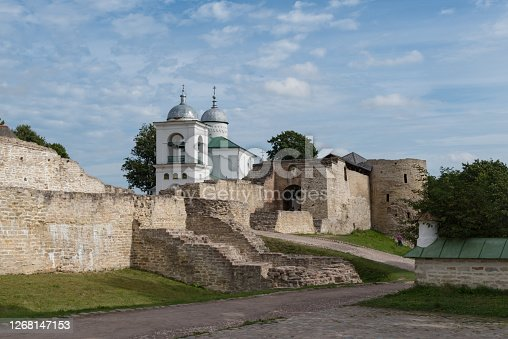 A view of the old Izborsk fortress, Nikolsky's defense sleeve, gates and St. Nicholas Cathedral of 14th century behind the fortified walls. Pskov region, Russia.