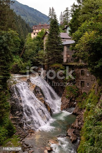 View of the old mill house and waterfall  in the Austrian city Bad Gastein.