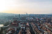 View of the old town from the top of the bell tower of Bern Minster during the sunset