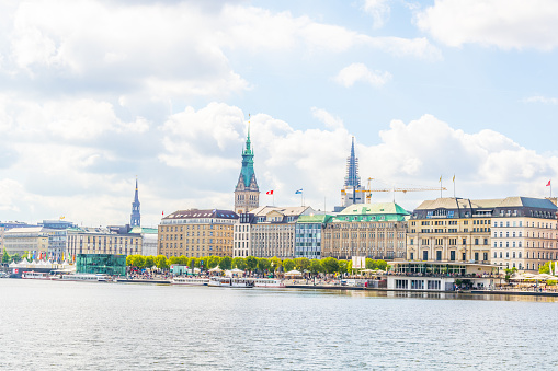 View of the old town in Hamburg behind aussenalster lake, Germany