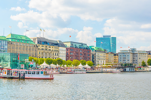 View of the old town in Hamburg behind binnenalster lake, Germany