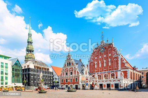 istock View of the Old Town Ratslaukums square, Roland Statue, The Blackheads House near St Peters Cathedral against blue sky in Riga, Latvia. Summer sunny day 1142988361