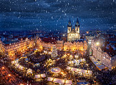 View of the old town square of Prague, Czech Republic, during winter time with the traditional Christmas Market under snow