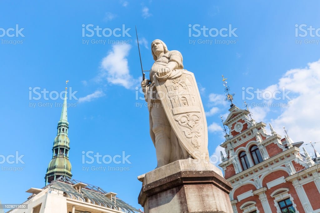 View of the Old Town square, Roland Statue, The Blackheads House and St Peters Cathedral against blue sky in Riga, Latvia. Summer sunny day stock photo