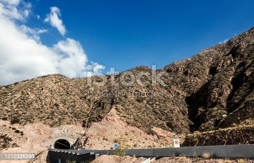istock View of the Pan-American Highway and the tunnel, which connects Argentina and Chile, in the Andes Mountains, Mendoza province, Argentina. 1212336395