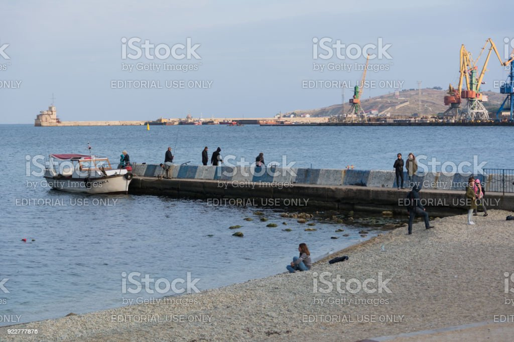 View of the pier on the beach of Feodosia stock photo