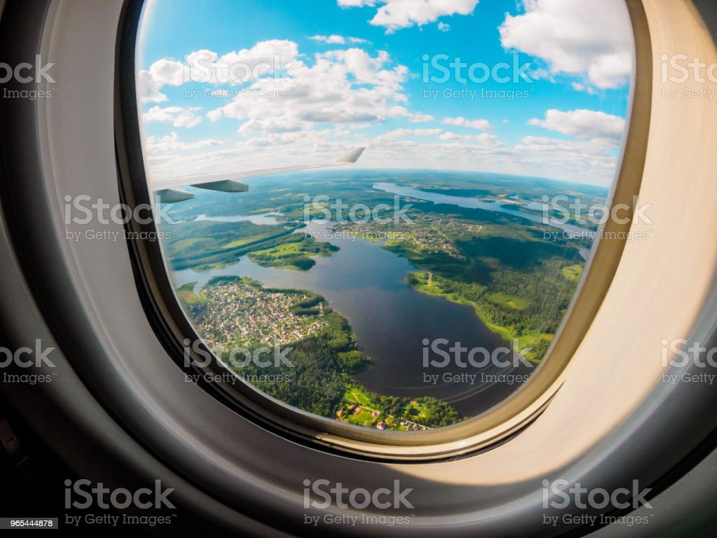 View of the planet Earth through the airplane porthole zbiór zdjęć royalty-free