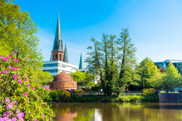 View of the pond and St. Lamberti Church of Oldenburg, Germany View of the pond and St. Lamberti Church of Oldenburg, Germany. lower saxony stock pictures, royalty-free photos & images