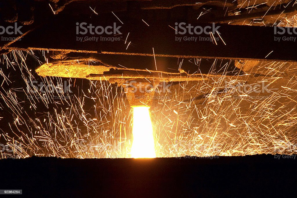 A view of the process of molten steel pouring stock photo