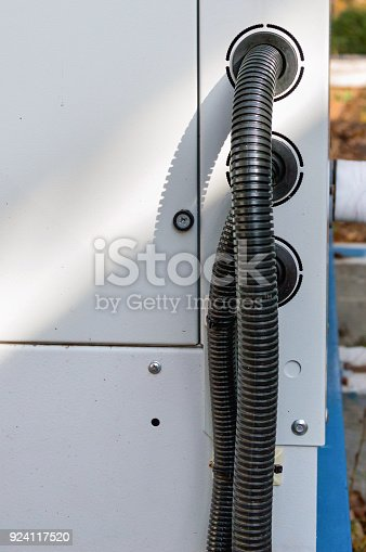 istock View of the protected wires connected to the industrial cooling unit for central ventilation system 924117520