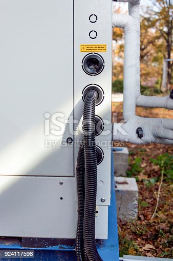 istock View of the protected wires connected to the industrial cooling unit for central ventilation system 924117596