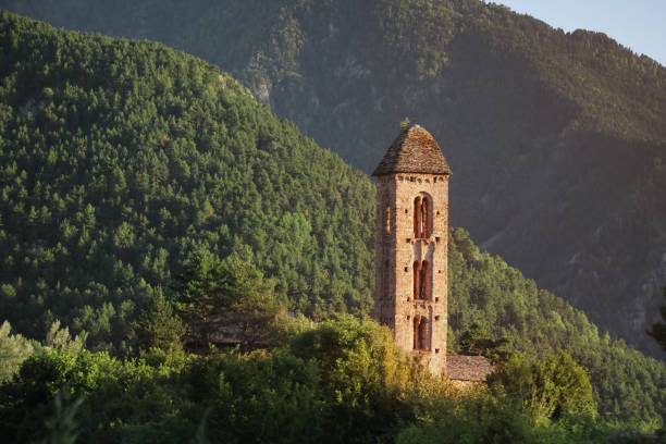 View of the Pyrenees Mountains and the brick tower stock photo