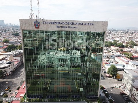 Guadalajara, Mexico - July 15 2018: View of the rectory tower of the Autonomous University of Guadalajara with the reflection of the museum of arts