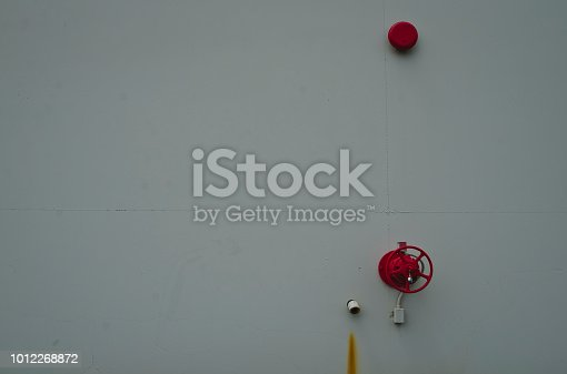 istock A view of the red fire bells on the white walls 1012268872